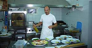 The chef at La Favarotta, where they know how to cook and serve good food